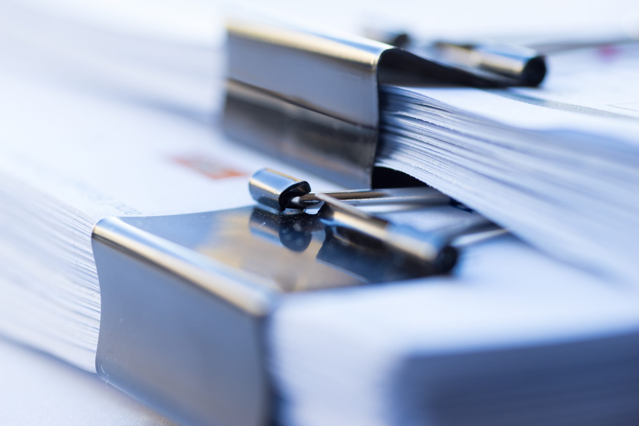 Piles Of Documents With Black Clip