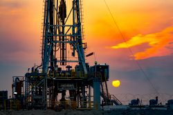 Drilling Rig At Sunset In Basra