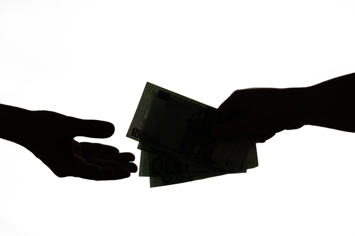 Silhouette Of Business Man Hands Giving Bribe Isolated On White Background. Dark Economy, Corruption Concept