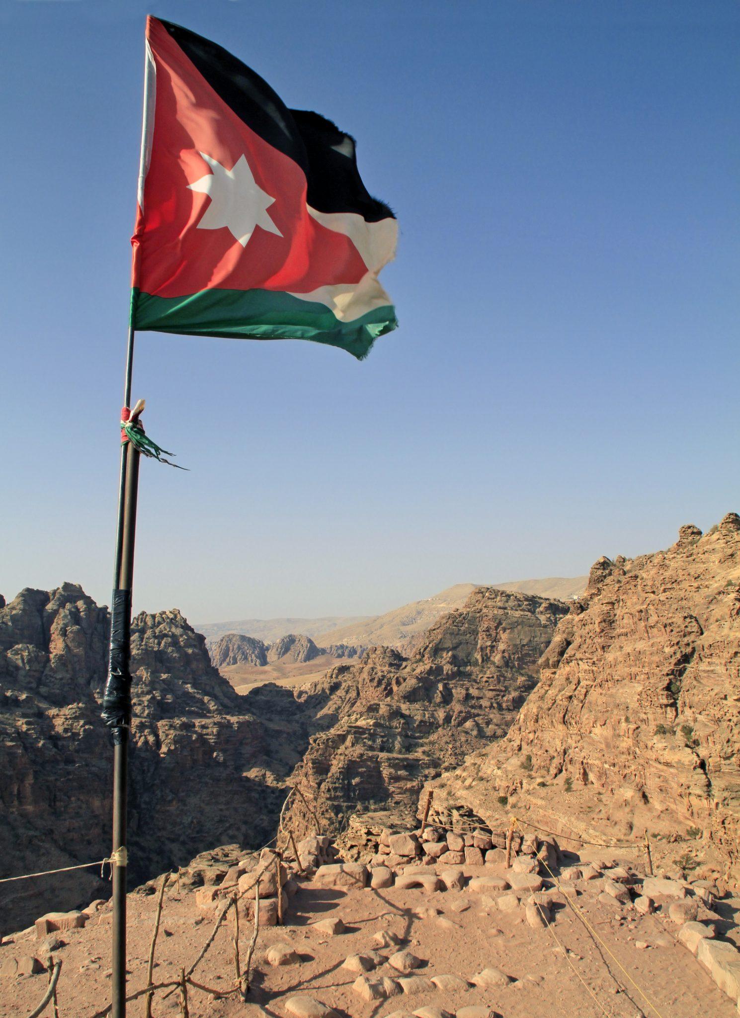 The National Flag Of Jordan Over Petra